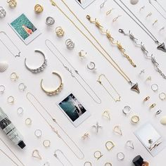 Featuring a row of pearlescent baubles on a rhodium plated bangle, the Pearls in a Pod Cuff is a sleek, on trend outfit update. Style this jewel with other delicate wrist pieces or wear it on its own