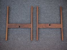 Mid Century Plant Stand Made of solid walnut dowels, I hand carved the curve in the cross piece to accept the dowel. The joint is reinforced with a floating mortise and tenon.