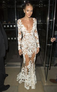 Candice Swanepoel looks perfect and leaves little to the imagination in this nude illusion gown!