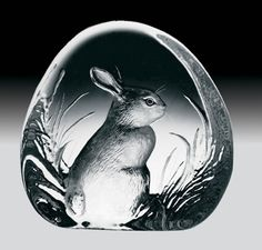 Crystal Bunny Rabbit Figurine-Combining an enthusiastic love of nature, incomparable craftsmanship, and the finest grade of Swedish art glass, the award winning Mats Jonasson Crystal Studios creates stunning crystal wildlife figurines with exceptional beauty and detail. Each piece comes nicely gift boxed including a biography of the artist. Available at AllSculptures.com