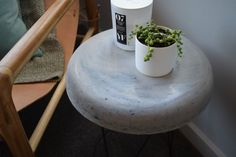 Our love of all things concrete and Kmart hacks continues with our DIY concrete side table! This is so simple, cheap as chips and we LOVE the results!