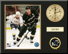 One 8 x 10 inch Anaheim Ducks photo of Corey Perry inserted in a gold slide-in frame and mounted on a 12 x 15 inch solid black finish plaque.  Also features a 3-inch Arabian gold-faced clock, a customizable nameplate* and a 2-inch hockey medallion with a gold base.  $59.99  @ ArtandMore.com