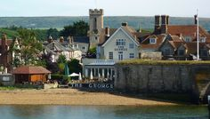 The George Hotel - Hotel on the Isle of Wight ..... Smart interiors give way to a sun-trapping garden from which to watch boats glide by - lovely food and country-house bedrooms wait .  Recommended in Alistair's Sawdays Newsletter. Read on ..