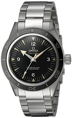 Stainless steel case with a stainless steel bracelet. Uni-directional rotating stainless steel bezel with black ceramic top ring. Black dial with silver-tone hands and index hour markers. Arabic numer...
