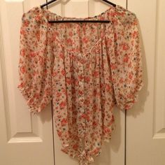 NEW LISTING Poetry size L Floral blouse! EUC! I am selling an adorable Poetry Floral button  down floral blouse size L! This shirt has a tie at the bottom! It would be adorable paired with a pair of jean shorts for those nice summer days! This shirt is in excellent condition and has no stains! It is 100% polyester. Ask any questions before buying! I ship next day! I don't ship on weekends! Poetry Tops Button Down Shirts