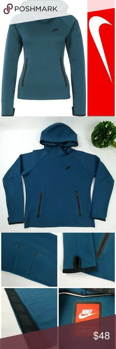 """Nike tech funnel pullover hoodie Nike tech funnel pullover hoodie.  In excellent used condition. Space blue color with black logo and trim. Has thumb holes and one big  pocket with a zipper on each side. 69% cotton 39%polyester Armpit to armpit laying flat 21"""" Waist 18.5"""" Length 22"""" Has a very tiny white line by the elbow part you can see it in 3rd pic in the top left picture. Its barely noticable. Nike Tops Sweatshirts & Hoodies"""