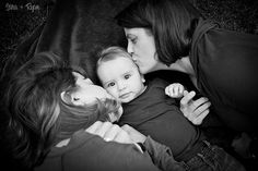 Two gorgeous mothers kiss their baby boy, marriage equality, family equality, LGBT
