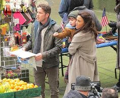 (New York setting) Robin Hood (Sean Maguire), wife Marian (Christie Laing) and son Roland (Raphael Alejandro) stroll through Chelsea like tourists with a big map when suddenly Roland points at something and his father runs towards it. Whatever's going on it's nice to know Robin Hood's family were not reduced to homelessness after leaving Storybrooke in season 4a.