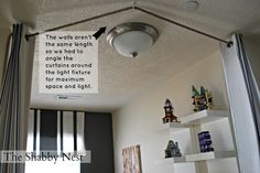 The Shabby Nest: An Ingenious Way to Hang Curtains~This would work great to cover up bookshelves.