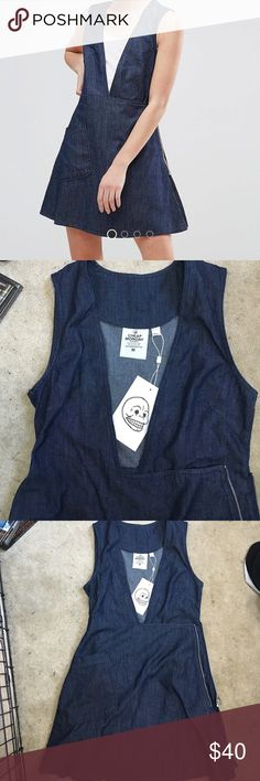 Cheap Monday wrap dress Brand new, never worn with tags. This is a cute Cheap Monday wrap around dress. It's a thin denim and has a pocket. Super hip and great for casual wear. Cheap Monday Dresses