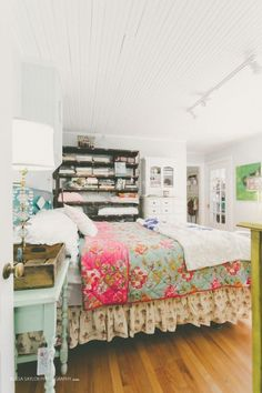 The Strawberry Patch turned a run down house into a flea market find filled cottage - love the mix of bedding prints and the open shelving in the bedroom eclecticallyvintage.com