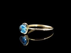 This solid 14 carat Gold ring features a wonderful Swiss Blue Topaz in a smooth Trillion cut. Blue Topaz Ring, Carat Gold, Solid Gold, Handcrafted Jewelry, Heart Ring, Gold Rings, Sapphire, Jewelry Making, Sterling Silver