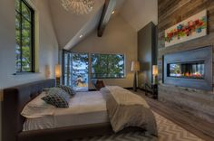 Love this #bedroom!  Gorgeous wall mounted #fireplace on a weathered wooden wall.