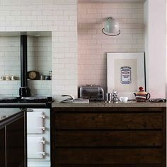 Strategically placed wall sconces provide focused lighting in kitchens and add a stylish note at the same time.