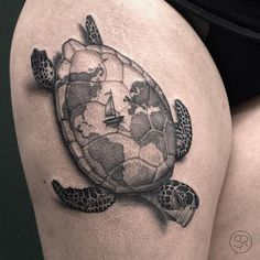The world map on the turtle shell seems somewhat mystical and attractive. Tattoo of an adventurer.