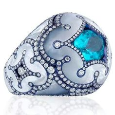 Fabulous ring from Lugano Diamonds with a Paraiba and diamonds set in mother of pearl and titanium