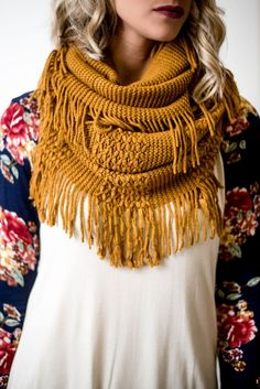 Our Mustard Ribbed Infinity Fringe Scarf is an incredibly soft knitted scarf that is giving us all the feels! The textured pattern and fringe detail will keep you cozy and warm all winter long.