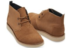 TOMS Chestnut Brown Embossed Suede Mens Chukka Mateo Boots: A low-profile boot built for versatility and freedom, this Chukka Boot features a stylish chestnut brown suede upperand a durable sole. Chestnut Brown Suedeupper Pull tab for easy fit. Cable-stitched welt Removable, molded antimicrobial footbed for added comfort and breathable support. Lightweight EVA outsole with serrated pattern for increased traction and comfort With every pair of shoes you purchase, TOMS will give a new pair…