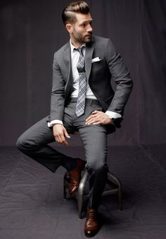 tailored men's gray suit and plaid tie