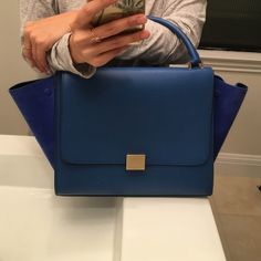 Celine Trapeze! In like new condition Amazing, AMAZING Celine Trapeze in the most beautiful blue leather and suede flaps. Only carried once and always kept in a dust bag! Comes with removable shoulder strap, care cards, and original dust bag. The exterior leather is unbelievably smooth, and the interior leather are buttery soft leather. I'm flawless condition. Guaranteed authentic! Celine Bags