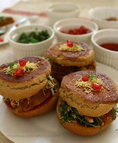 dabeli - a kind of indian slider stuffed with spiced mashed potatoes and all sweet & spicy edibles.