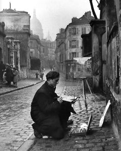 Edward Clark: Artist painting at the streets of Montmartre, Paris, 1946.