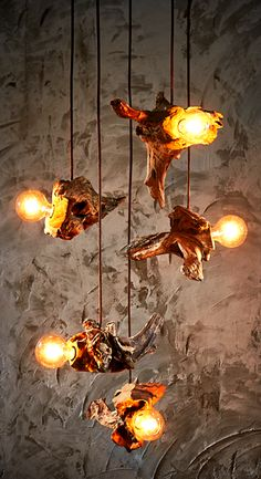 How creative is that !? I mean this is Great Hanging Lamp idea. How could the designer came up with this simple yet eye-catching lighting. Natural Teak roots and Edison bulbs? Well done O'THENTIQUE...