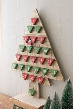 "Add some holiday cheer and a charming yuletide ritual to your home with this wooden holiday tree! Product Details: Dimensions: 19"" x 25""t"