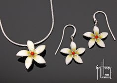How beautiful. The Plumeria flower in sterling silver and hard fired enamel.  Heirloom quality jewelry inspired by the art of Guy Harvey.