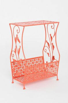 Flourish Storage Side Table. Super cute and only $49. Might be too girly alongside all the other girly things I own but the color is definitely interesting.