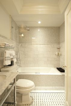 The Renovated Home - bathrooms - chic bathrooms, shower partition, glass shower partition, half shower door, two tone shower tiles, 2 tone s...