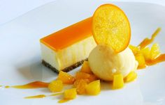 Passion Fruit & White Chocolate Cheesecake - Great British Chefs - Passion fruit and white chocolate cheesecake with fresh orange sorbet by Matthew Tomkinson - Fancy Desserts, Just Desserts, Dessert Recipes, Health Desserts, Chef Recipes, Chocolate Cheesecake Recipes, Chocolate Desserts, Fruit Cheesecake, Chocolate Cake