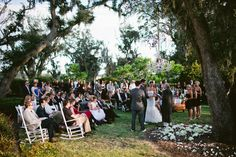 south carolina wedding on Ruffled.  Love the setting, love the rocking chairs especially!