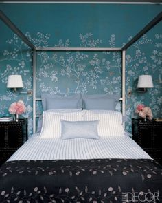 Miles Redd In a bedroom designed by Miles Redd the Earlham wall covering is by De Gournay, the black-lacquer bedside cabinets are vintage Chinese, and the wall lamps are by Bill Blass for Visual Comfort.