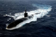 US Navy 40712 002 The Los Angeles class submarine USS Albuquerque (SSN surfaces in the Atlantic Ocean while participating in Majestic Eagle 2004 Us Submarines, Utility Boat, Nuclear Submarine, Cabin Cruiser, The Motley Fool, Images Wallpaper, Wallpapers, Armada, United States Navy