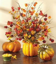 Love the pretty fall colors in this pumpkin flower arrangement!