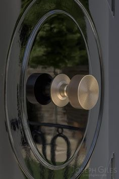Joseph Giles antique brass centre door knob with rings