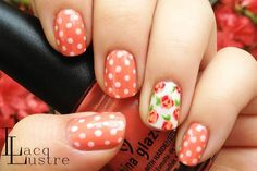 Polka dots are a foolproof nail art option—they're easy to do and easy to look good. Mix it up by painting a floral print on one of the nails in a matching hue.
