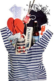 "For a New England celebration, all things nautical: lobster lollipops, rope bracelets, and slip-knot stationery. Blue-and-white striped tote bag, Red flip-flops, Sailing-knot cards, Custom s'mores kit, Paisley Quill; Navy blue pashmina, Lobster lollipop, Beer, Soap, Rope bracelet, $7.99, Nantucket Knotworks; Custom ""Wedding S.O.S."" bag, The English Pea; Cape Cod Potato chips"