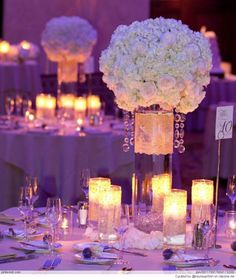 Wedding centerpieces Ideas: white flowers and the soft glow of candlelight.