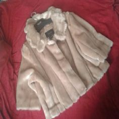 Faux fur shrug Like new condition. Worn only once. The size is 3x, in the picture is how it would look on someone that wears XL. Great piece over formal attire for added drama. :-) Terry Lewis Dresses Prom