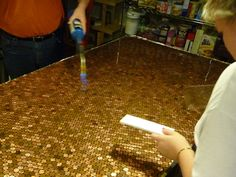 Penny Countertop - I think it would be really cool on a bar.  Whole kitchen might take a couple hundred dollars in pennies to do...don't know if I have quite that many!  =)