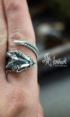 Silver wire wrapped adjustable ring.
