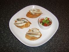 Poached mackerel is flaked before being added to warm bruschetta and served with a simple salsa