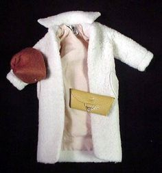 Vintage Barbie Peachy Fleecy #915 (1959-1961)    Beige Fleece Coat  Mustard Vinyl Purse  Brown Felt Hat with Feather and Pearl  White Vinyl Gloves  Brown Open Toe Heels    This pretty beige coat has a back half-belt and patch pockets. It is fairly easy to find in decent condition.    The gloves and purse are harder to find. The brown hat is often found with the feather and pearl missing. It is very hard to find with these intact.    The coat should have the black & white cloth tag. The 1959…