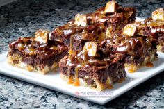 Rich triple chocolate chunk cookie crust layered with Snickers bits, a rich & fudgy brownie and even more Snickers! But wait,. there's more! The whole thing is finished with a drizzle of chocol…