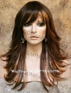 deep auburn with blonde highlights and lowlights, layers with long bangs.