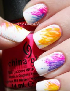 White and colorful nails done with a toothpick