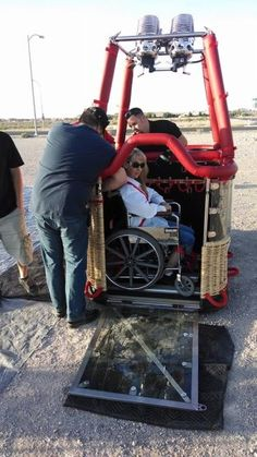 A Woman in a Wheelchair Prepares for Her Hot-Air Balloon Experience.  So many amazing things to do in this world!