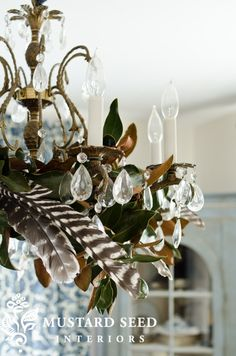 Fall chandelier with magnolia leaves and feathers...
